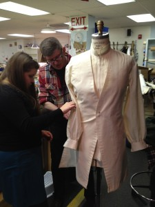17. Randall and costume intern Stephanie discuss the mock-up on a dress form