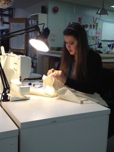 18. Costume Intern Stephanie sewing the mock-up