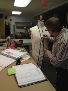 9. Randall begins draping a pattern on a dress form