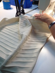 32. Donna working on the pleats in Dorante's shirt