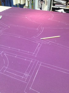 41. the pattern pieces for the breeches have been traced out onto the fabric, ready to cut