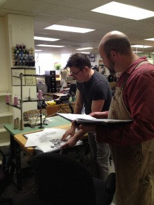 44.Murell discusses silk screen options with Josh Kelley, Lead Crafts Artisan