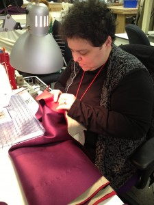 58. Stitcher Donna Sachs working on Dorante's coat