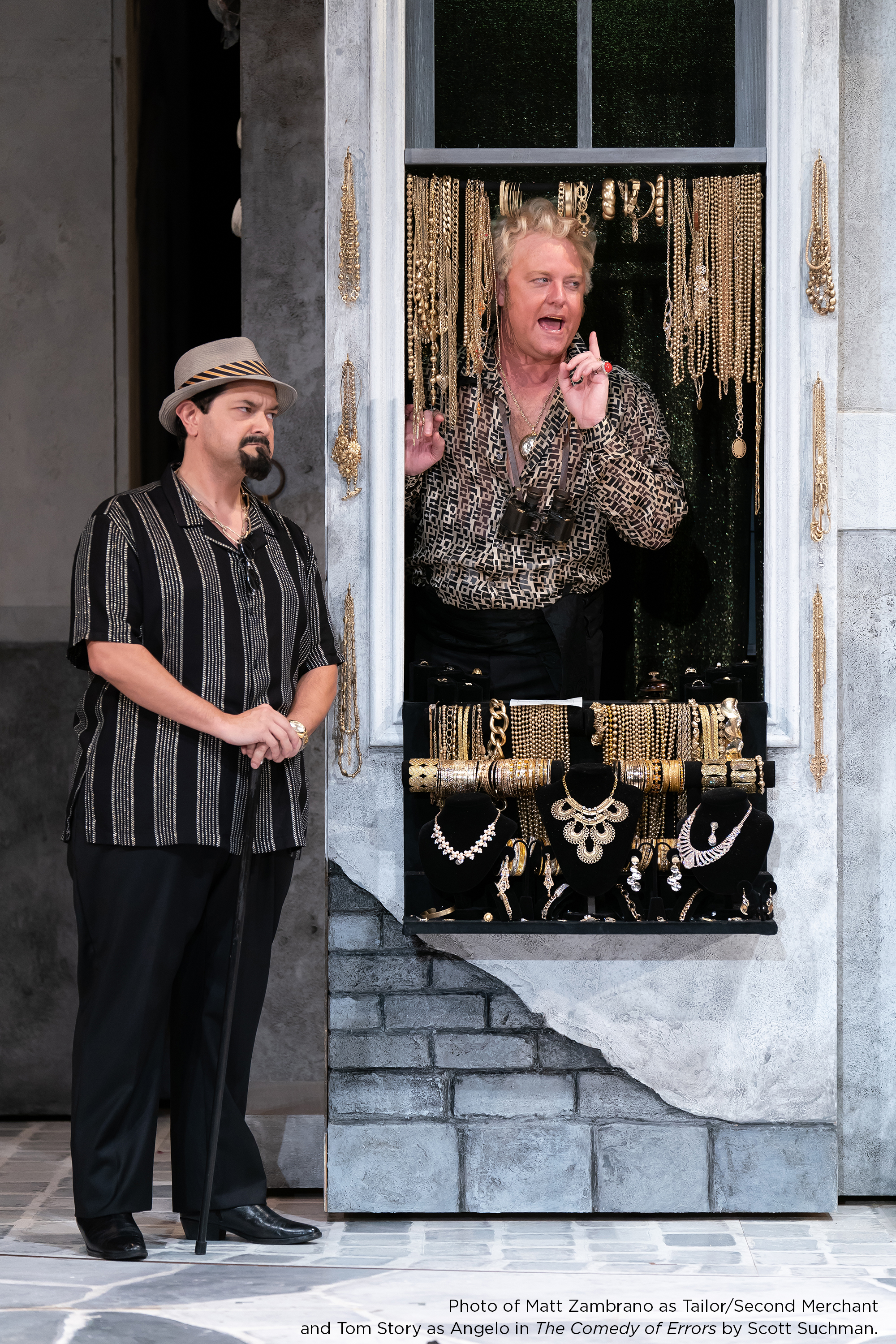 Photo of Matt Zambrano as Tailor/Second Merchant and Tom Story as Angelo in The Comedy of Errors by Scott Suchman.