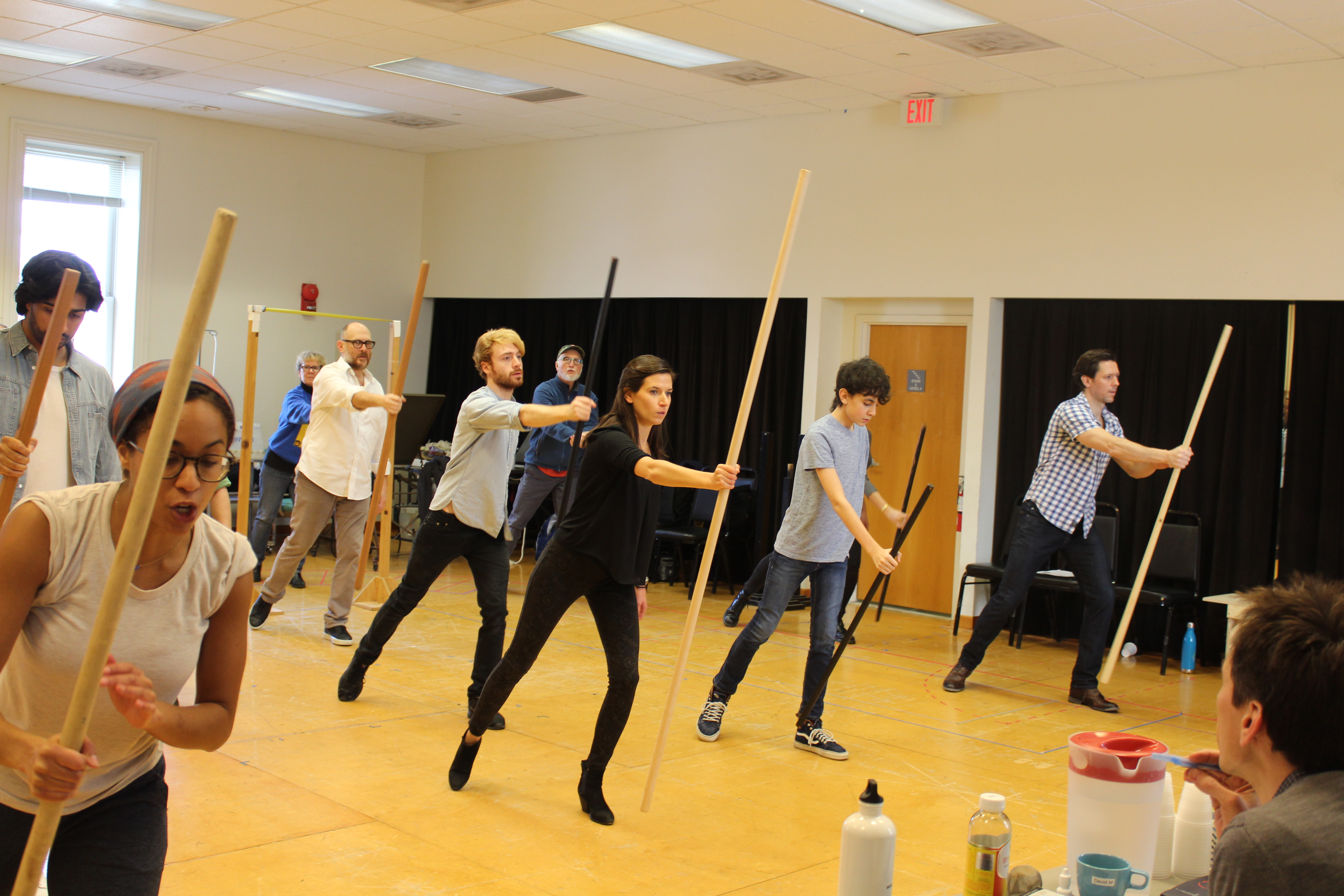 Photo of the cast of RICHARD THE THIRD and Movement Director Steph Paul in rehearsal.