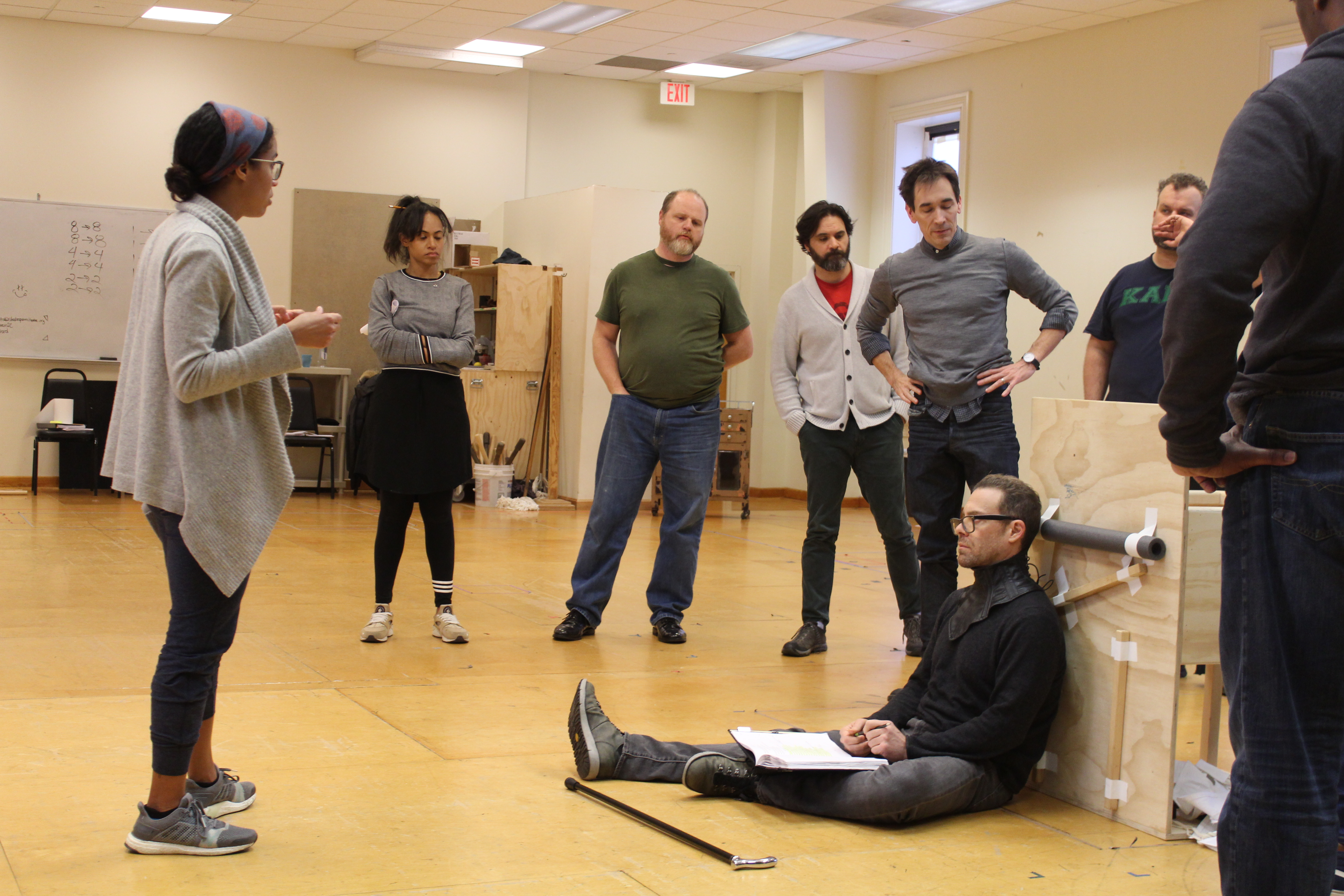 Photo of Movement Director Steph Paul (left), Director David Muse (center, in gray) and the cast of RICHARD THE THIRD in rehearsal.