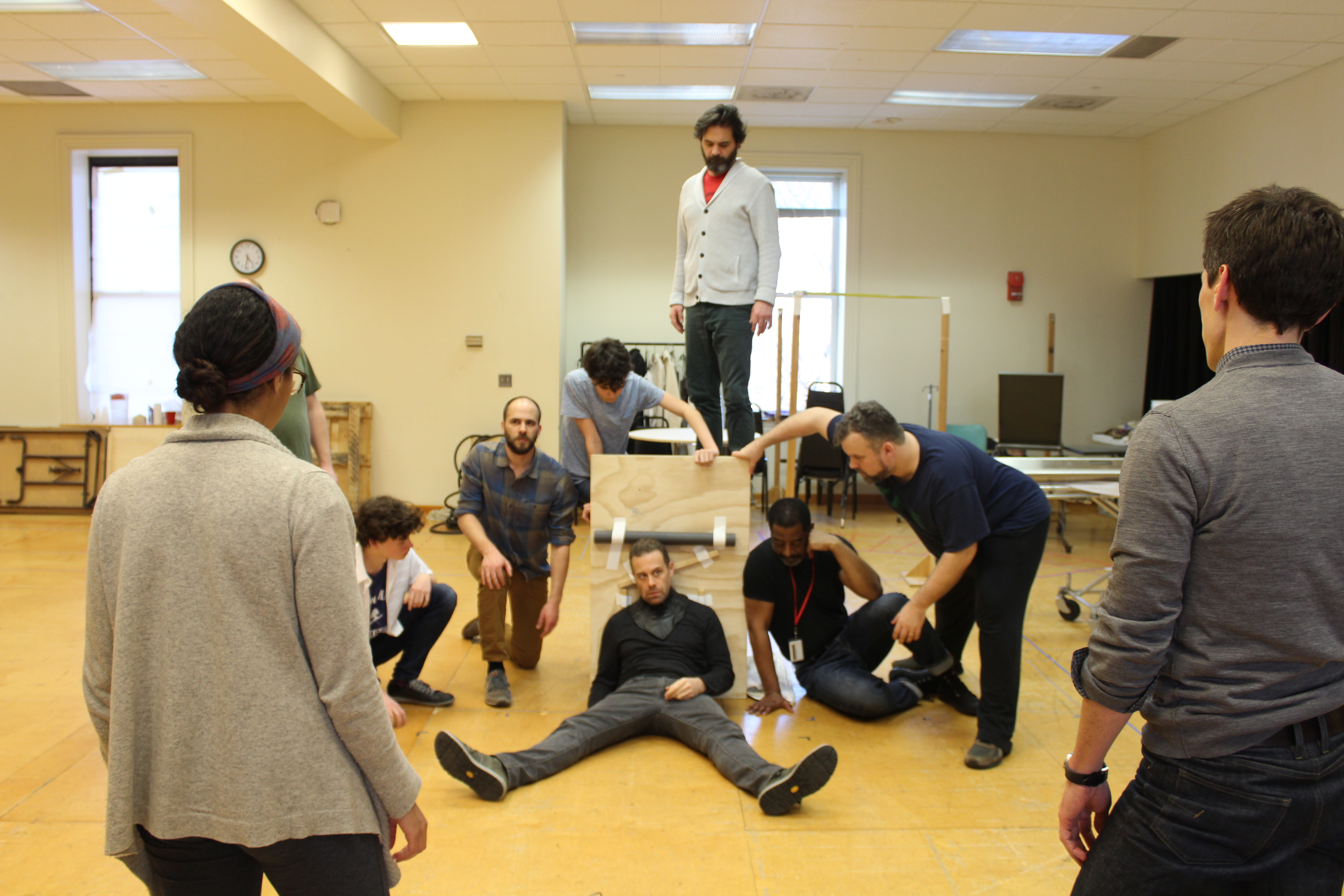 Photo of the cast of RICHARD THE THIRD, Movement Director Steph Paul and Director David Muse in rehearsal.