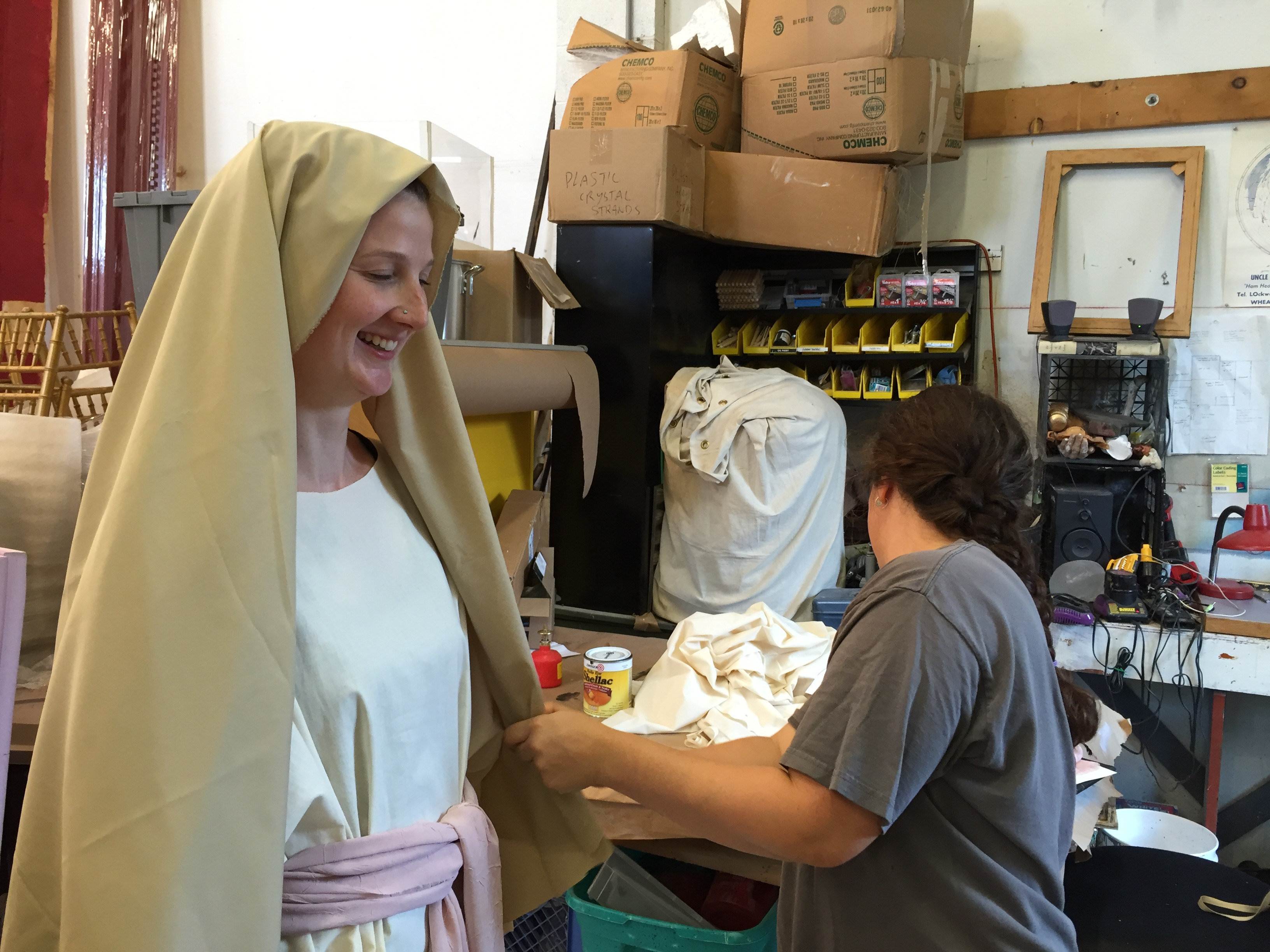 The Paint Shop's Laura Genson poses as a reference for Props Painter/Sculptor Eric Hammesfahr. Eric is working on a Madonna statue to be used for ROMEO & JULIET.