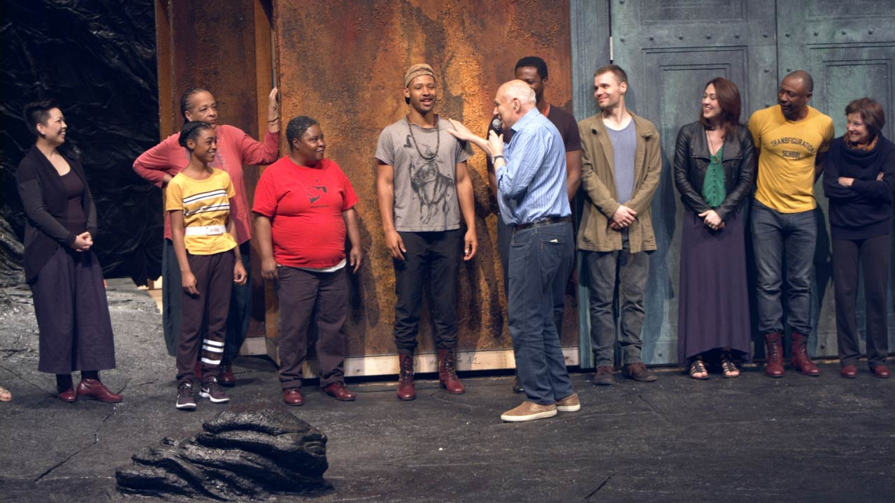 Photo of the cast of The Oresteia and Director Michael Kahn in rehearsal.