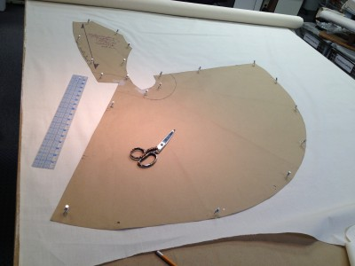 12. a pattern piece read to be traced onto muslin