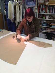 13. first hand, Sandra  Thomas begins tracing and cutting out pattern from muslin for a mock-up