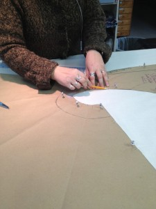 15. first hand Sandra Thomas begins tracing and cutting out pattern from muslin for a mock-up