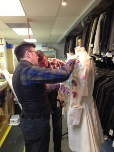 34. Designer Murell and draper Randall discuss trim placement on the muslin mock-up