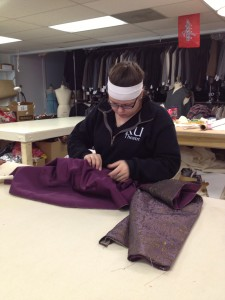 59. Costume intern, Stephanie working on Dorante's waistcoat